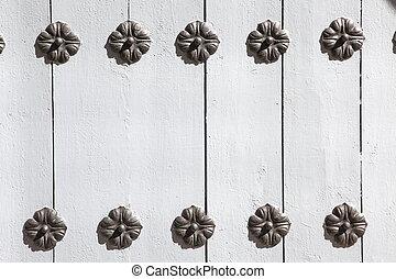 old wood door with meatal decor