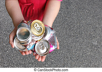 Child Recycling Aluminum Cans - Recycling Aluminum Cans in a...