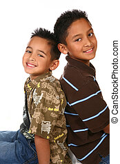 Hispanic American Brothers Sitting and Smiling - Hispanic...