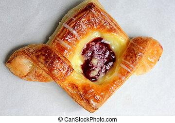 cherry danish -  a cherry danish puff pastry on white