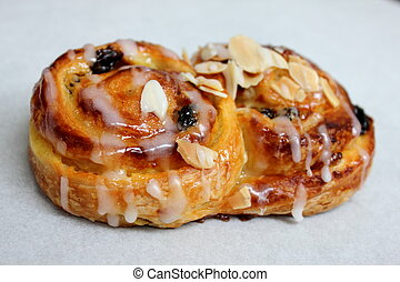 raisin roll danish on white background - a raisin roll...