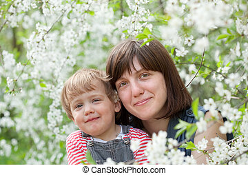 Happy mother with toddler  in spring