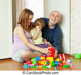 Happy parents and child in home - Happy parents and child...