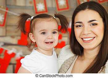 Happy smiling mother with daughter