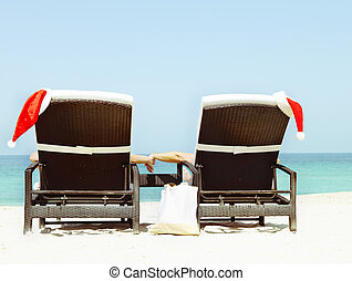 Christmas card or background - couple in sunloungers with...