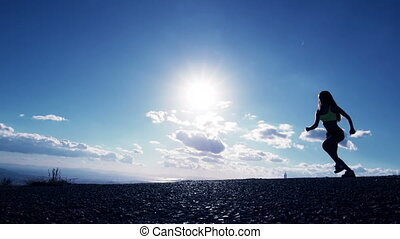Woman Jumping At Sunset - Super Slow Motion Shot Captured at...