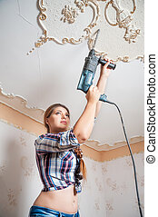 Attractive woman with puncher - Pretty woman with building...