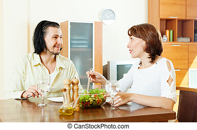 woman with man eating  vegetables salad