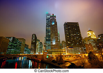Chicago at night and mist - Chicagos urban skyscrapers in...