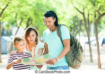 couple with teenage child traveling together - Happy couple...