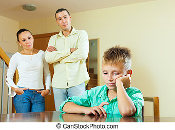 teenage son and parents having quarrel - teenage son and...