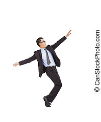 businessman feel happy to raise his hands and dancing