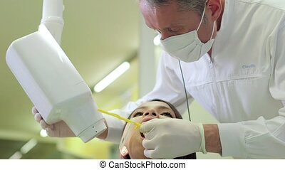 Dentist visiting patient in studio - Dentist visiting young...