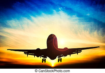 Abstract sunset and airplane - Airplane silhouette with...