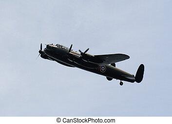 Soaring Lancaster - A Lancaster bomber soaring against a...
