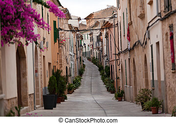 Street in old town of Alcudia . Majorca, Spain