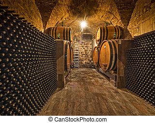 wine bottles and oak barrels - wine bottles and barrels in...
