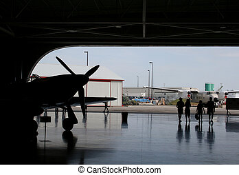 Air Plane Hangar Silhouette - The silhouette an antique...