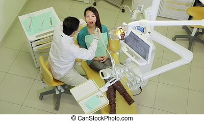 Dentist visiting patient in studio