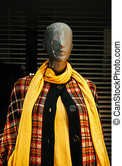 Mannequin in coat and neck scarf - Boutique display window...