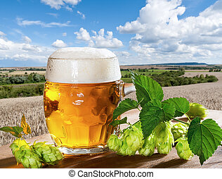 still life with beer - beer with raw material for beer...