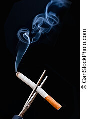 Quit smoking  - Burning cigarette being cut with scissors
