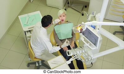 Dentist visiting patient in studio - Man working as doctor,...