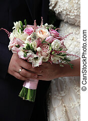 Wedding bouquet - Newly-married couple with bouquet from...