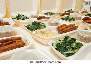 Lunch boxes - White styrofoam lunch boxes containing tofu,...