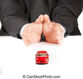 businessman protect with his hands a red car, concept for...