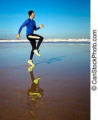 athlete on beach - young man working out at the beach
