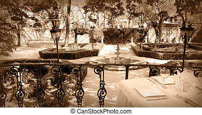 Banquet table on a terrace in a garden