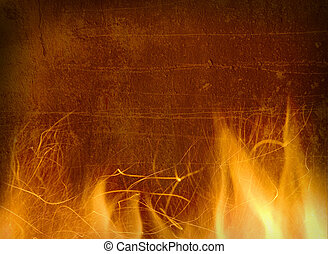 Close-up of fire and flames on a background of an old wall