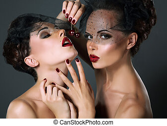 Dainty. Two Provocative Women in Veils with Cherry Berries....