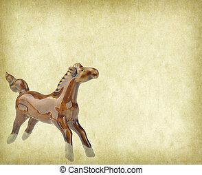 Ceramic horse souvenir on old paper,2014 is year of the...