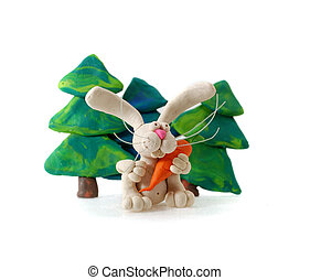 Plasticine rabbit. - Plasticine rabbit with carrot against...
