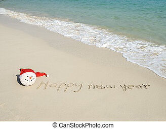 happy new year message on the sand beach