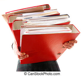 Female office worker carrying a stack of files