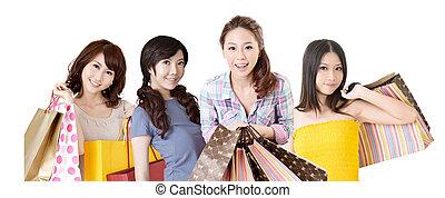 shopping women - Happy smiling Asian shopping women on white...