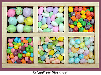 colorful Easter candy in wooden tray