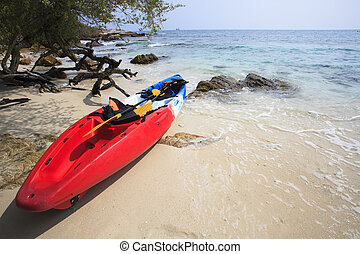 sea kayak canoe on sea sand beach with beautiful nature...