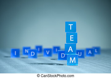 Teamwork versus individualism metaphor. Tower made from...