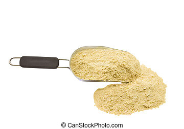 yeast flakes - A scoop of nutritional yeast flakes isolated...