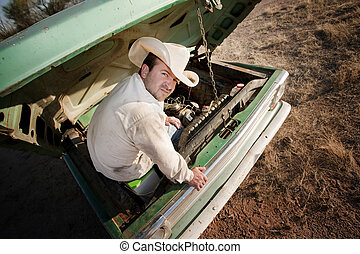 Man under the hood of his truck