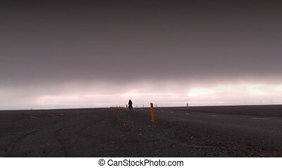 cyclist in deserted landscape in iceland