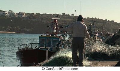 fishermen preparing net closeup - fishermen preparing net in...
