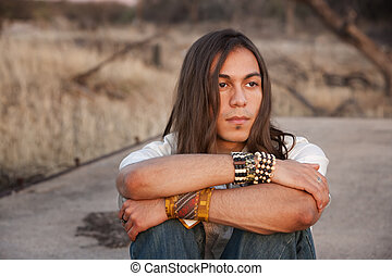 Handsome Young Man - Handsome young man with long hair in an...