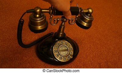 Telephone old - pick up - hand picks up an old fashioned...
