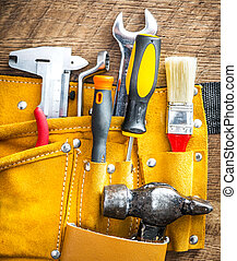 tools and instruments - set of tools in a bag on wooden...