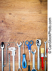 tools and instruments - set of tools on a wooden background...